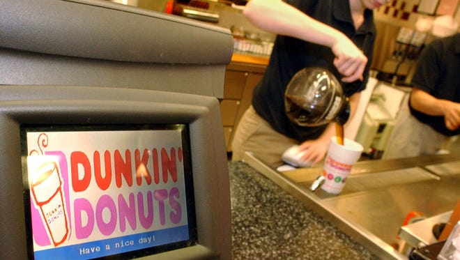 Local Dunkin' Donuts' franchisees donated about 300 pounds of coffee to Rochester-based food bank earlier this week.