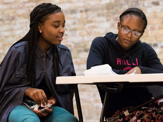 """Jayonna Yahsha, left, and Akaiia Ridley run through a scene for the upcoming production of """"History Repeats Itself"""" at the Bohm Theatre in Albion."""
