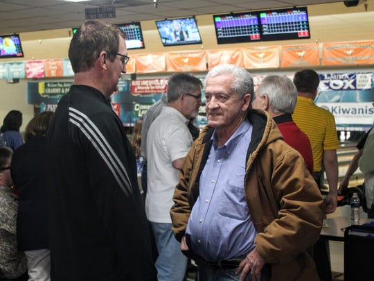 Livonia Mayor Dennis Wright speaks with Dave Rexroth,