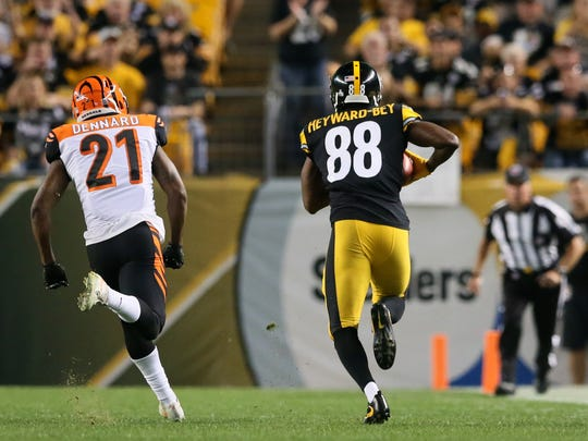 Pittsburgh Steelers wide receiver Darrius Heyward-Bey (88) catches a pass for a first down on a fake punt play as Cincinnati Bengals cornerback Darqueze Dennard (21) defends in the fourth quarter during the Week 7 NFL game between the Cincinnati Bengals and the Pittsburgh Steelers, Sunday, Oct. 22, 2017, at Heinz Field in Pittsburgh.