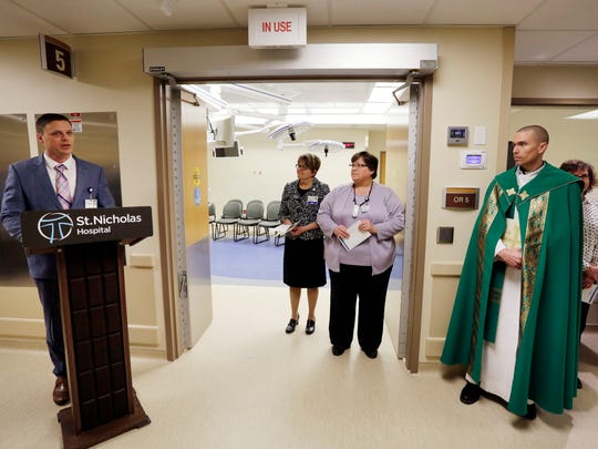 HSHS St. Nicholas Hospital President and CEO Andy Bagnall, left, speaks during a dedication ceremony for new operating rooms Thursday February 23, 2017 in Sheboygan. From left, Chief Nursing officer Mary Martin, Director of Surgical Services Therese Belanger, RN, and Rev. Matthew Widder listen to Bagnall's remarks.