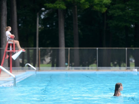A swimmer enjoys plenty of open water at Colburn Pool in Green Bay. The pool opened in 1967 and needs renovations.