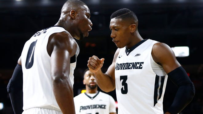 Providence Friars forward Ben Bentil (0) and guard Kris Dunn (3) celebrate against the Boston College Eagles during the first half at Dunkin Donuts Center.