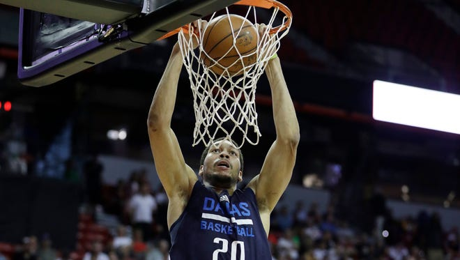 Dallas Mavericks' AJ Hammons dunks against the Chicago Bulls during the second half of an NBA summer league basketball game Thursday, July 14, 2016, in Las Vegas.
