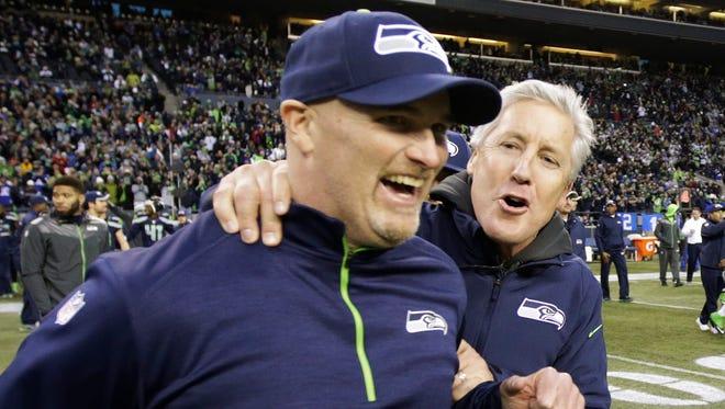 Seattle Seahawks defensive coordinator Dan Quinn, left, celebrates win over the St. Louis Rams on Dec. 28, 2014, in Seattle.