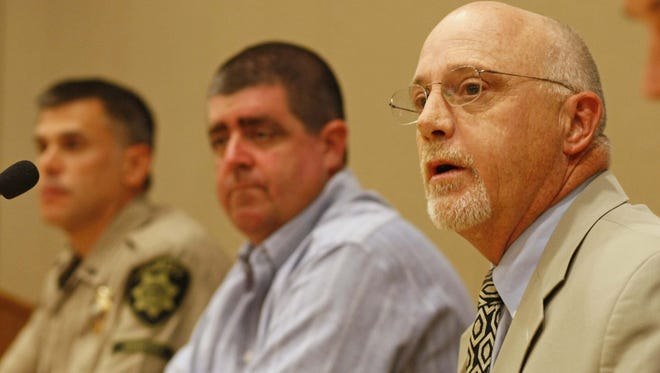 Marion County Deputy District Attorney Donald Abar (front right), Kevin Fredinburg (center) and Marion County Sheriff Jason Myers (left rear) during a press conference held at the Keizer Civic Center, on Monday Aug. 6, 2012.