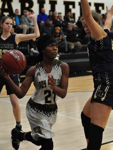 Abilene High's Trakenya Roberson passes the ball to