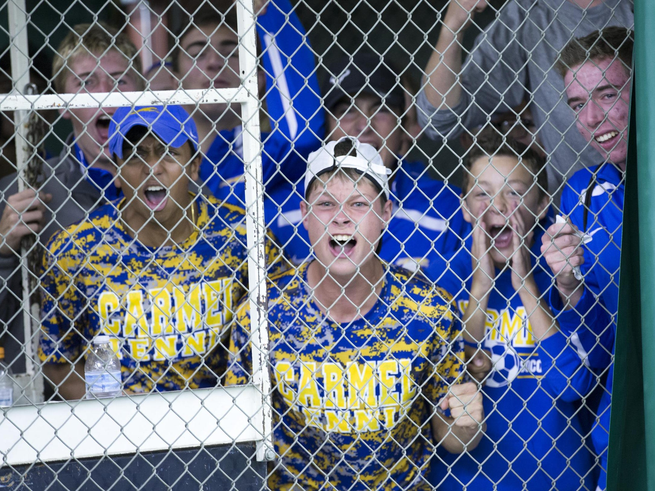 Carmel High School fans yell for their team, IHSAA Boys Team Tennis State Finals, Indianapolis, Saturday, October 18, 2014.