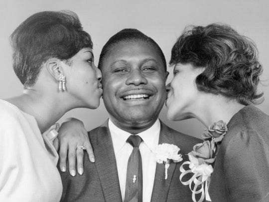 The Rev. C. L. Franklin with his daughters, Aretha and Carolyn, on May 18, 1965.
