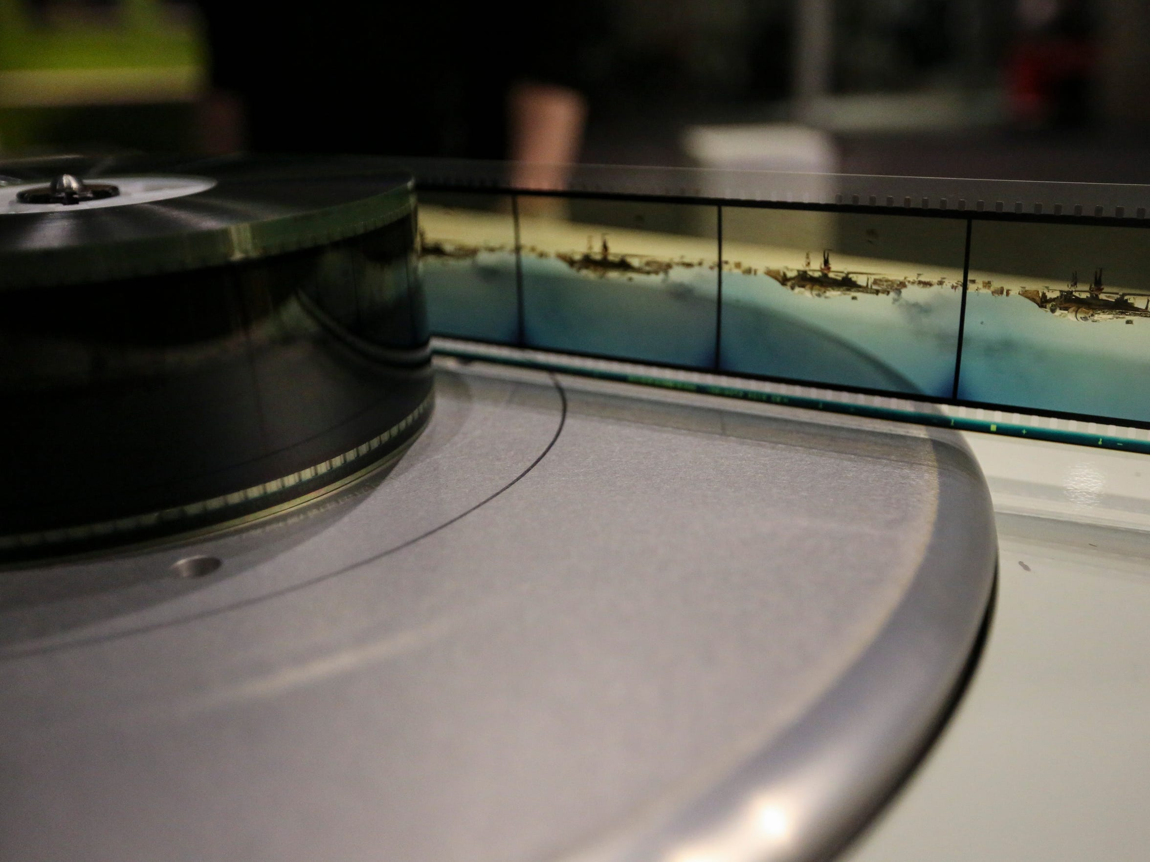 "A strip of 70mm IMAX film of ""Star Wars: The Force Awakens"" is spun on to the film reel."