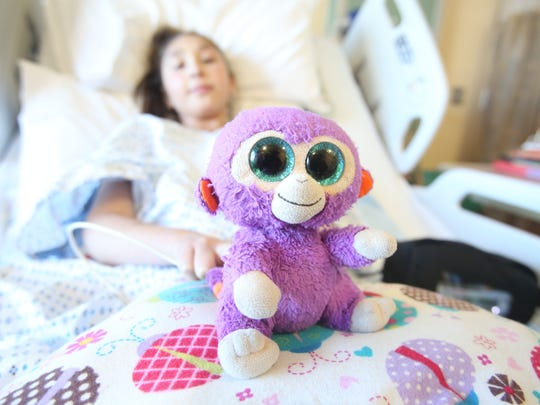 Grape, the stuffed monkey that sits in the bed with Isabella  Mu–oz, 12, at Morgan Stanley Children's Hospital in Manhattan Jan. 25, 2018.  Bella has been in the hospital since Jan. 6th  waiting for open heart surgery, and the stuffed monkey has not left her bedside since she was diagnosed with a heart condition two years ago.