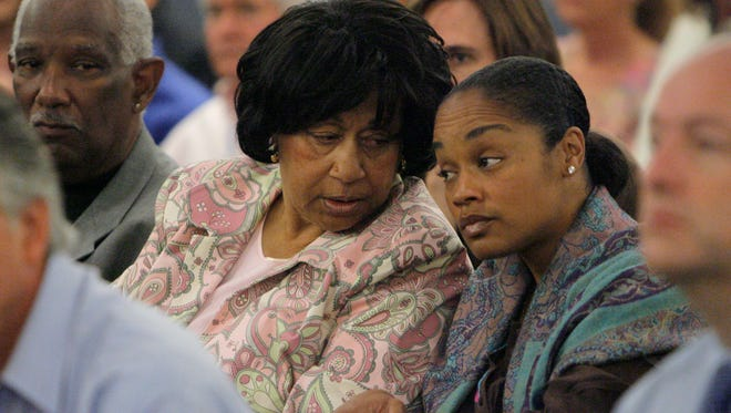 Arnelle Simpson, right, O.J. Simpson's daughter, and Shirley Baker, Simpson's sister, chat during a court appearance in 2007.