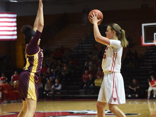 Marist College's Kendall Baab looks to pass against