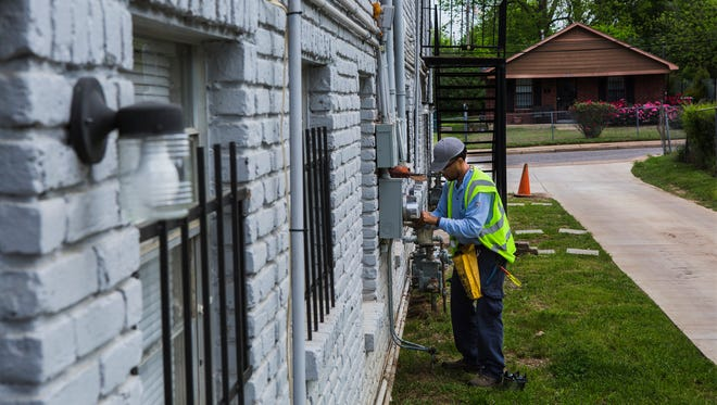 May 2, 2018 - Maricco Rhodes, an electric meter technician for MLGW, installs a smart meter in South Memphis on Wednesday morning. MLGW restarts utility disconnections today, on Sept. 14, 2020, after taking a two-week breaking.