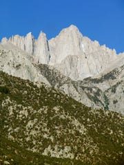 Mount Whitney towers above the Sierra from Whitney Portal Road.