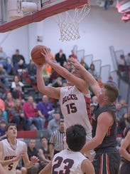 Jacob Shade attempts a layup against Seneca East earlier