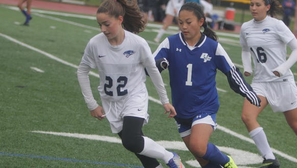 Action during a Section 1 girls soccer Class B first