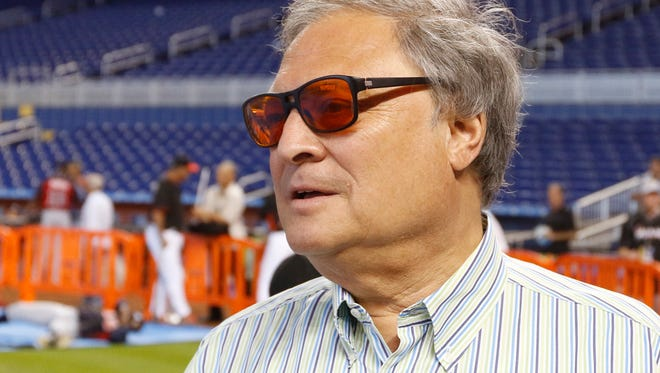 """In this April 7, 2015, file photo, Miami Marlins owner Jeffrey Loria speaks with reporters before the Marlins met the Atlanta Braves in a baseball game in Miami.  The Kushner family, which has close ties to the White House, has put the brakes on its negotiations to buy the Marlins because of a report team owner Jeffrey Loria may be nominated by President Trump to become ambassador to France. Joshua Kushner, whose older brother is an adviser to the president, has a preliminary agreement to buy the Marlins. But in a statement released late Wednesday, Feb. 15, 2017,  by Kushner's brother-in- law, Joseph Meyer, the family expressed concern the deal might """"complicate"""" the ambassadorship appointment."""