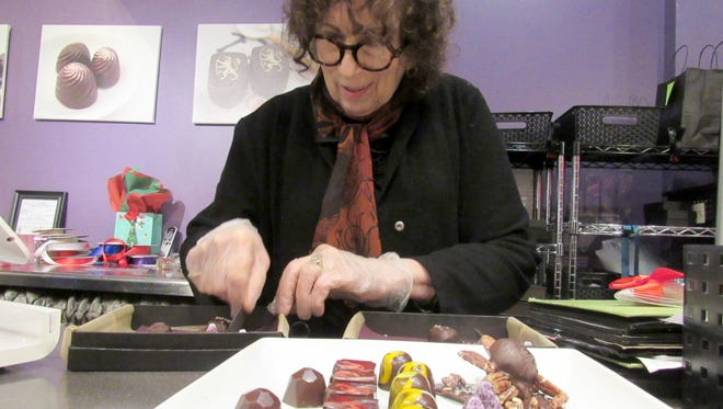 Cher Mandel Diamond sorts chocolate truffles at Maurie's Fine Chocolates in Madison. The store was named after her late father and she has owned and operated it for nearly 25 years. Mandel Diamond, 71, will close her Monroe Street shop and retire on Dec. 29.