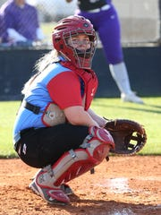 Maddie Neal looks towards the Gibson County dugout