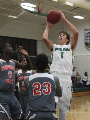 Fort Myers' Connor Jenkins shoots over Monignor Pace defenders during a game at Fort Myers High School on Tuesday.