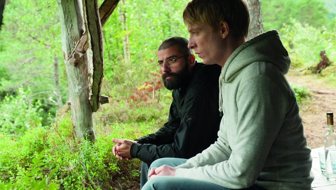 """Domhnall Gleeson, right, and Oscar Isaac in a scene from the of  the motion picture """"Ex Machina."""" CREDIT: Daniel landin,  A24 [Via MerlinFTP Drop]"""