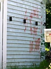 Racist graffiti adorned the side of a garage at a home on Sheboygan's west side Wednesday, June 21, 2017.