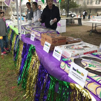 Take a run, eat some king cake to help stop domestic violence