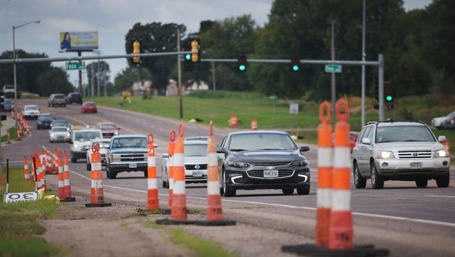 Cones and signs align the right side of Arrowhead Parkway for anticipated construction Monday.