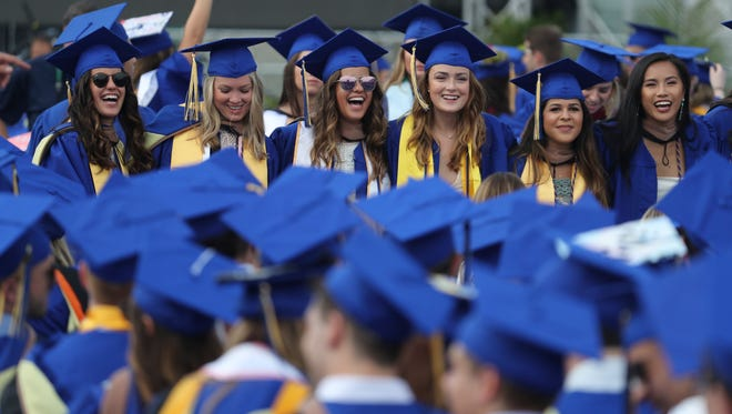 The University of Delaware hosts commencement ceremonies for approximately 6,200 graduates at Delaware Stadium Saturday.