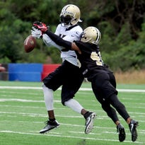 New Orleans Saints saftey Vonn Bell knocks the ball our of the hands of wide receiver Brandon Coleman (16) during the NFL football team's training camp in White Sulphur Springs, W.Va., Friday, July 29, 2016. (AP Photo/Chris Tilley)
