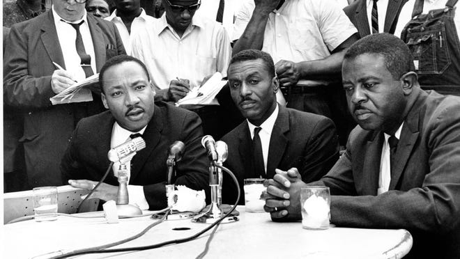 Civil rights leaders (from left) the Rev. Martin Luther King Jr., the Rev. Fred Shuttlesworth and the Rev. Ralph Abernathy hold a news conference in Birmingham, Alabama, on May 8, 1963.