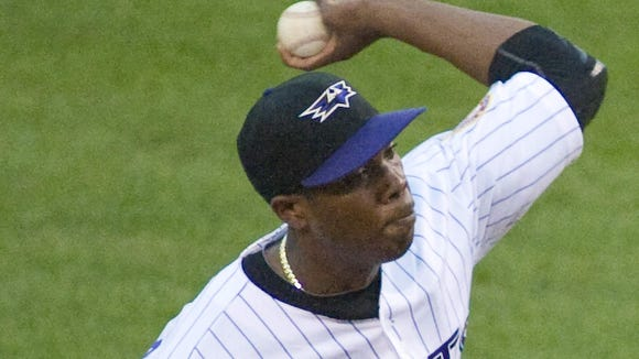 Aroldis Chapman pitches for the Bats in 2010