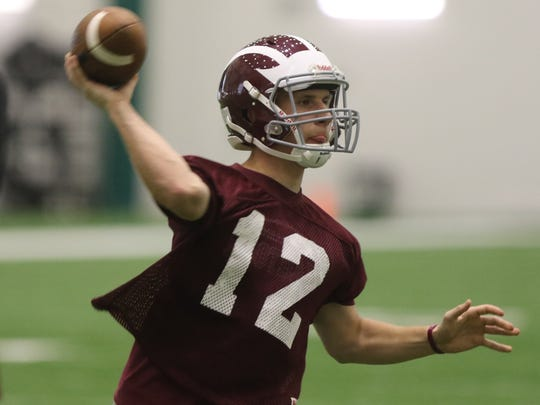 Morristown quarterback makes a throw while playing