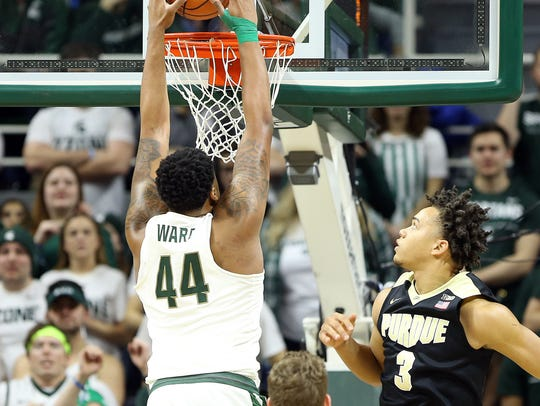 Nick Ward dunks against Purdue last season.