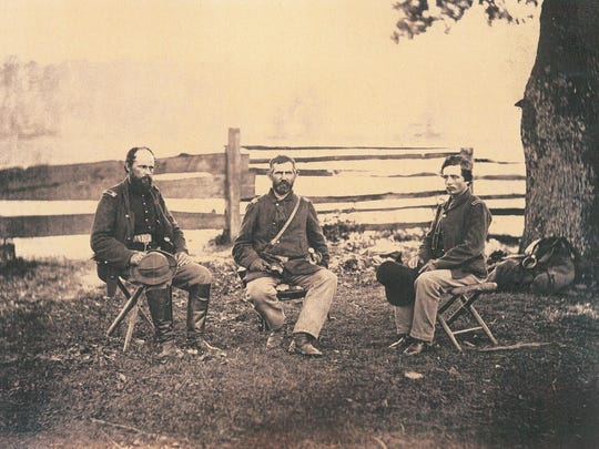 Civil War hero Gen. George Stannard, left, and two