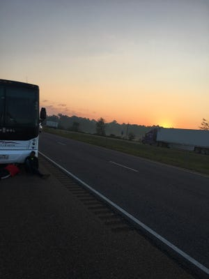 The Parkway bus sits on the side of the road at daybreak Saturday.