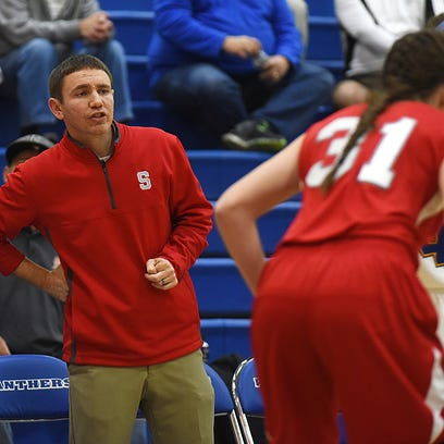 Sheridan head coach J. D. Walters watches his team