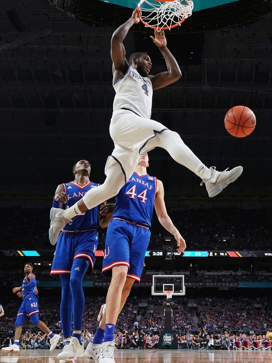 Villanova's Eric Paschall (4) dunks during the second half in the semifinals of the Final Four NCAA college basketball tournament against Kansas, Saturday, March 31, 2018, in San Antonio. (AP Photo/Chris Steppig, NCAA Photos Pool)
