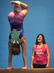 Suzi Otuafi, owner of Flips Gymnastics, works with