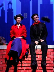 Kirsten Larson, playing Mary Poppins, sits with Grant