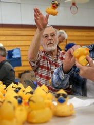 Dennis Crisman tosses a duck toward that's been prepared