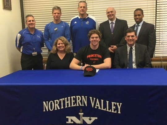 Connor Scaglione signing with Princeton: (seated, from left) Pam, Connor and Ben Scaglione; (standing) athletic director Greg Butler, track coach Mike Theuerkauf, football coach Tony Mottola, NV Superintendent of Schools James Santana and Principal Dr. Tim Gouraige.