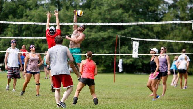A scene from the action at the Brightside/Coca-Cola Volleyball Classic in Seneca Park.  July 19, 2015.