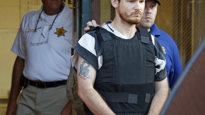 In this Thursday, Sept. 11, 2014 file photo, Smith County Sheriff Charlie Crumpton, left, watches as Timothy Ray Jones Jr., is escorted out of the Smith County Jail. Jury selection is set to begin Monday, April 29, 2019 in the death penalty trial of Jones who police said killed his five young children in their South Carolina home.