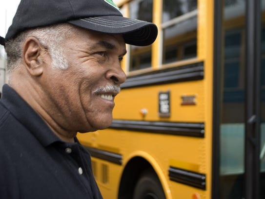 Al Martin stands next to a school bus at the Scottsdale Unified School District Bus Yard on May 1, 2009.