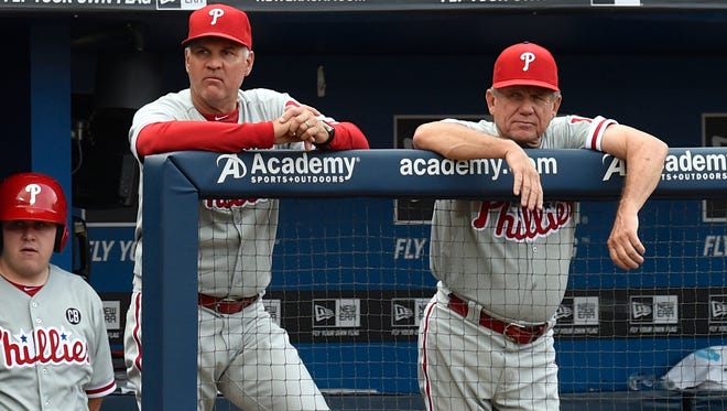 Philadelphia Phillies manager Ryne Sandberg (23) and bench coach Larry Bowa (10) (right) watch the action against the Atlanta Braves July 19 at Turner Field. Credit: Dale Zanine-USA TODAY Sports