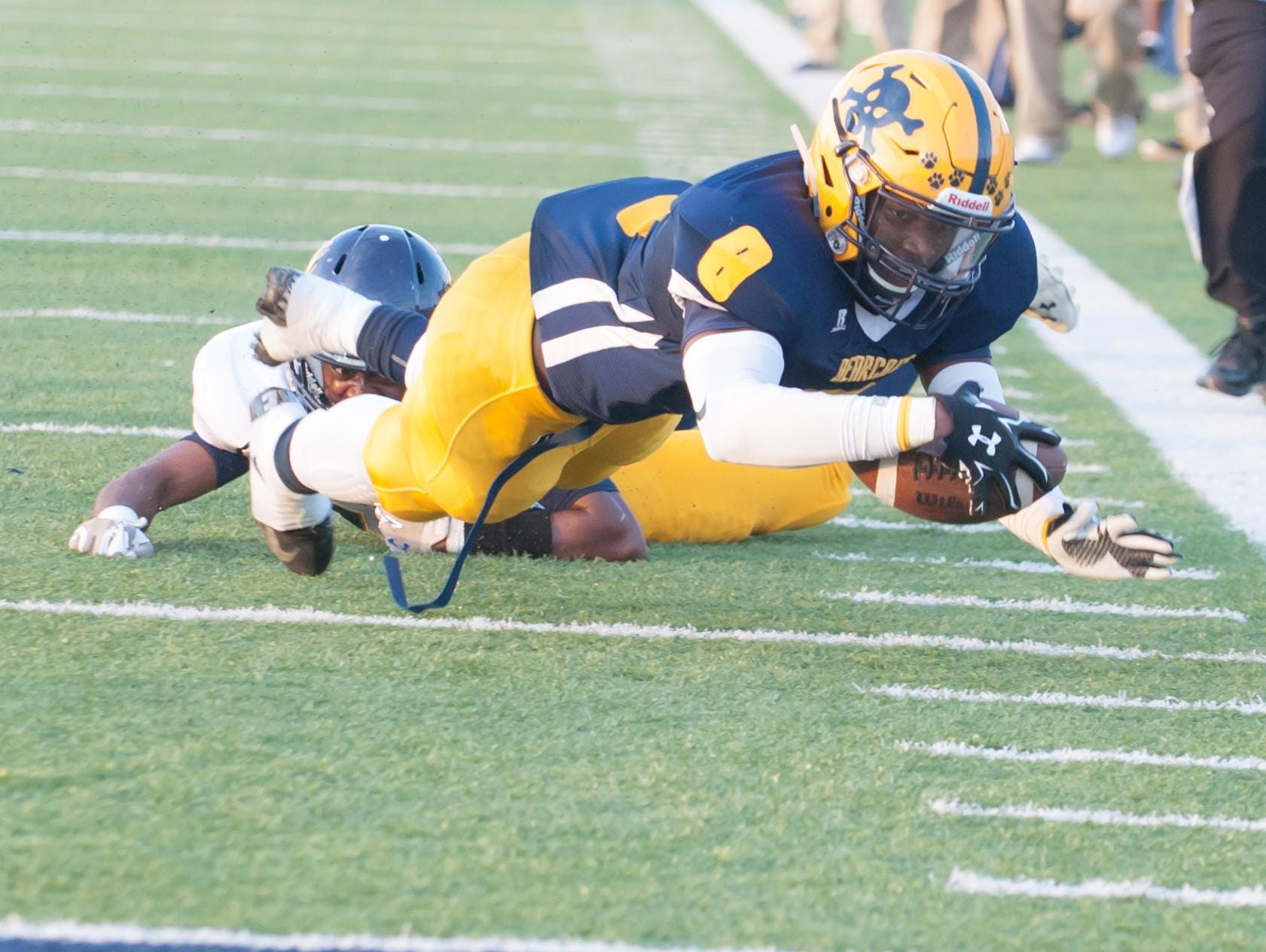 BCC QB Dennis Watson stretches for the goal line, but comes up short early in the first quarter.