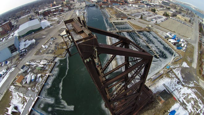 Pere Marquette bridge stands at the mouth of the Black River.  U.S. Army Corps of Engineers said there's no timeline as to when a final decision will be made on a demolition permit. The permit was filed nearly five years ago by the Port Huron Yacht Club who owns the land.