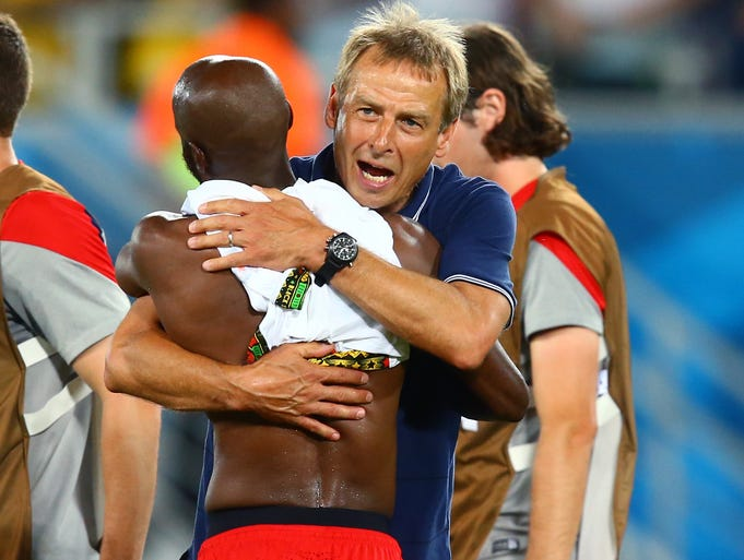 Coach Jurgen Klinsmann hugs defender DaMarcus Beasley following the 2-1 win over Ghana at Estadio das Dunas.